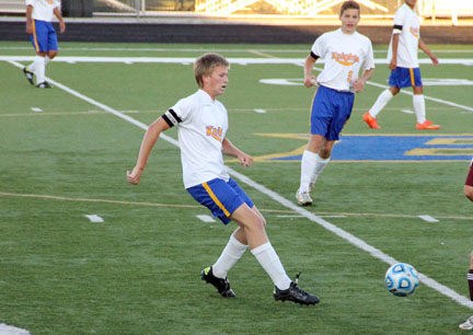 Senior Nate Housholder passes the ball to a teammate on the field.