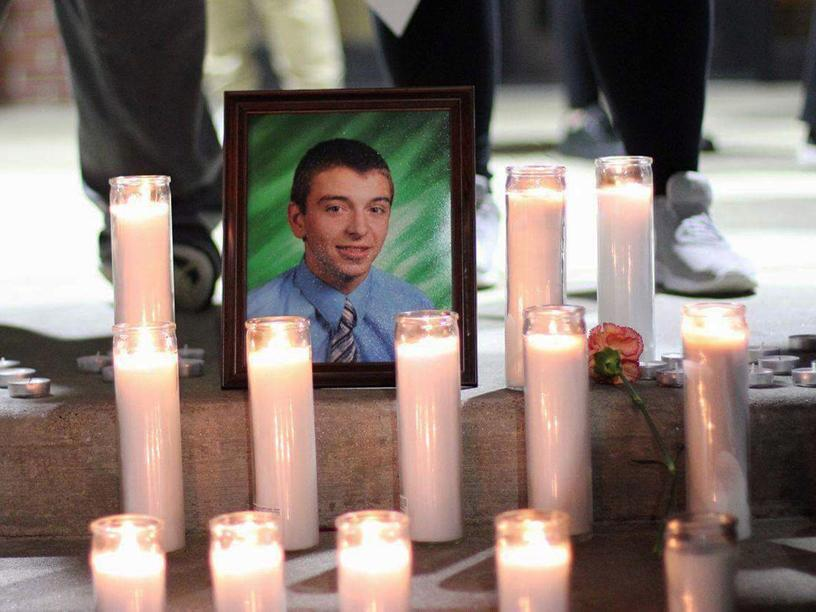 A portrait of the late Jacob Becker surrounded by candles at his vigil. Photograph by Maya Gay.