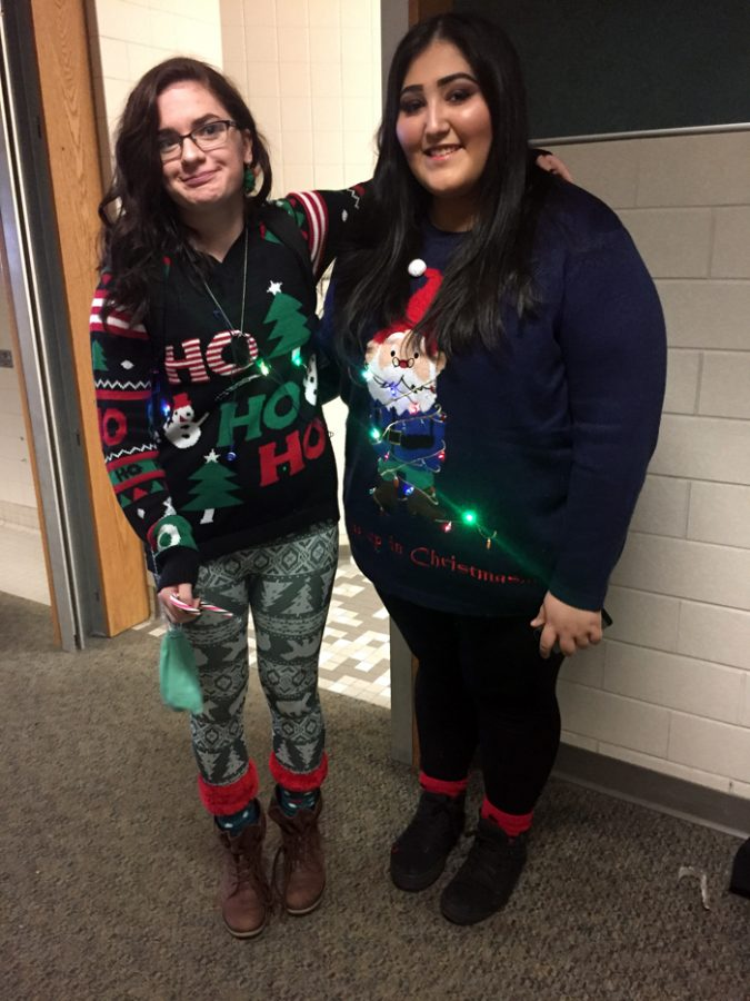 Juniors Nancy Abell and Jasmine Lovely spread Christmas cheer by wearing their light-up sweaters.